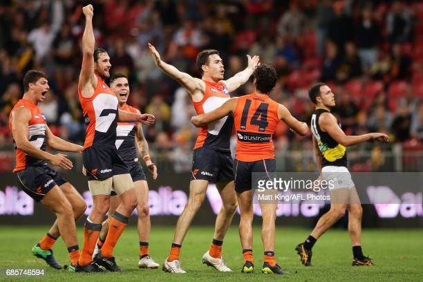 Jeremy Cameron of the Giants celebrates with team mates after kicking the winning goal during the round nine AFL match between the Greater Western...