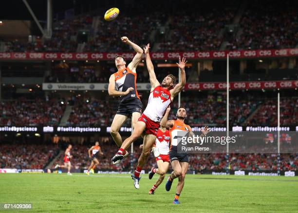Jeremy Cameron of the Giants competes for the ball against Harrison Marsh of the Swans during the round five AFL match between the Sydney Swans and...