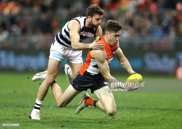 Jeremy Cameron of the Giants is tackled by Jordan Murdoch of the Cats during the round 15 AFL match between the Greater Western Sydney Giants and the...