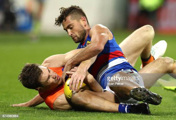 Jeremy Cameron of the Giants is tackled by Luke Dahlhaus of the Bulldogs during the round six AFL match between the Greater Western Sydney Giants and...