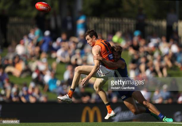 Jeremy Cameron of the Giants is tackled by Luke McDonald of the Kangaroos during the round three AFL match between the North Melbourne Kangaroos and...