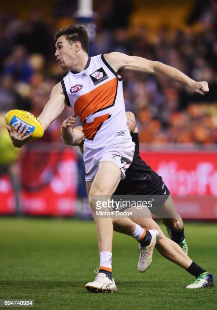 Jeremy Cameron of the Giants runs with the ball during the round 12 AFL match between the Carlton Blues and the Greater Western Sydney Giants at...