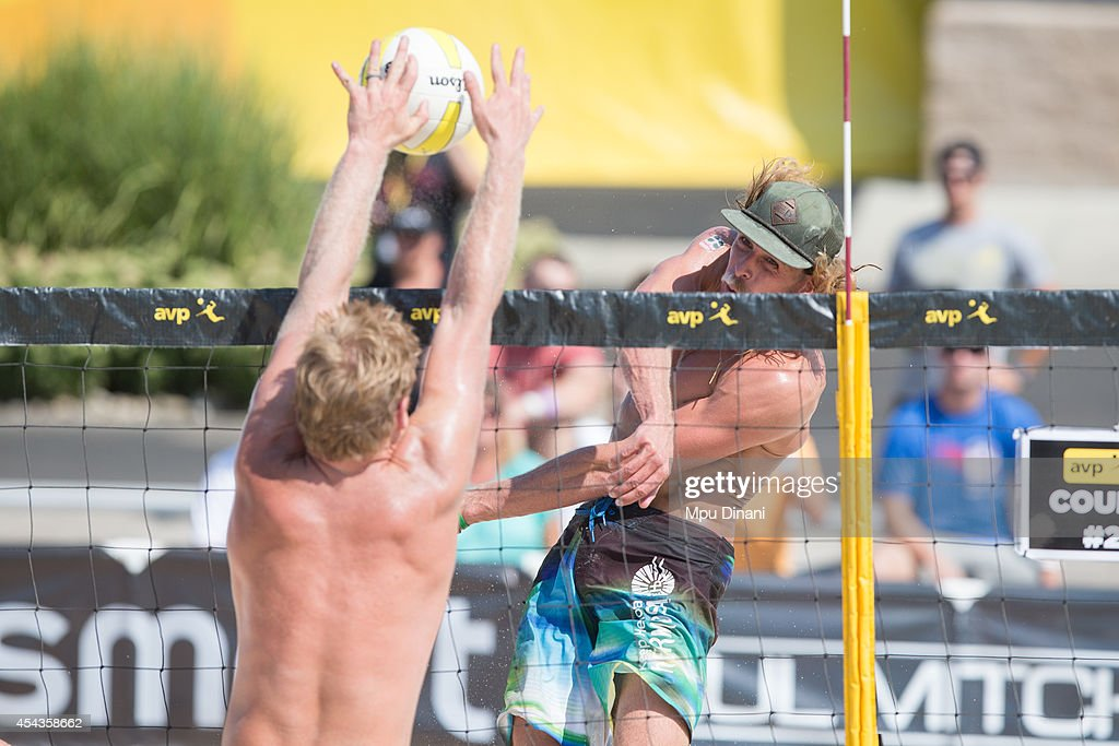Jeremy Casebeer (R) spikes the ball against Kevin McColloch (L) at the 2014 AVP Cincinnati Open on August 29, 2014 at the Lindner Family Tennis Center in Cincinnati, Ohio.