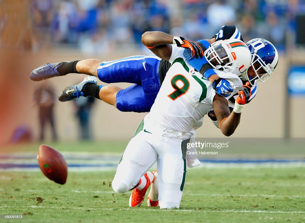 Jeremy Cash #16 of the Duke Blue Devils braks up a pass intended for Malcolm Lewis #9 of the Miami Hurricanes during play at Wallace Wade Stadium on November 16, 2013 in Durham, North Carolina.