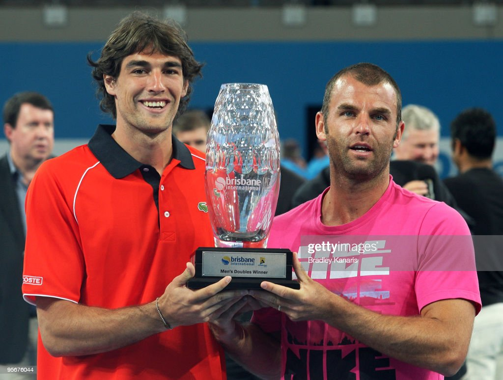 Jeremy Chardy of France (L) and Marcus Gicquel of France pose with their trophy after defeating Lucas Dlouhy of the Czech Republic and Leander Paes of India in the mens doubles final during day eight of the Brisbane International 2010 at Queensland Tennis Centre on January 10, 2010 in Brisbane, Australia.