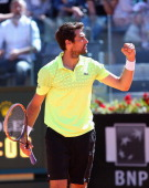 Jeremy Chardy of France celebrates defeating Roger Federer of Switzerland during day four of the Internazionali BNL d'Italia tennis 2014 on May 14...