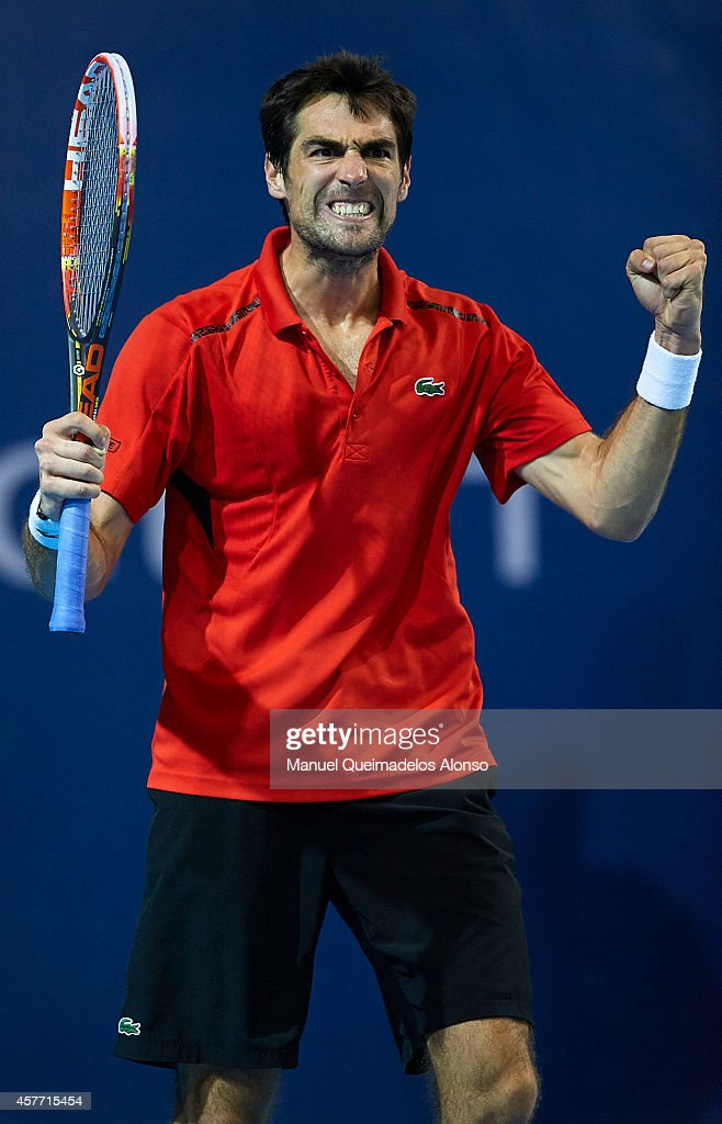 Jeremy Chardy of France celebrates match point against Alexandr Dolgopolov of Ukraine during day four of the ATP 500 World Tour Valencia Open tennis tournament at the Ciudad de las Artes y las Ciencias on October 23, 2014 in Valencia, Spain.