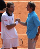 Jeremy Chardy of France celebrates with coach Frederic Fontang after winning his match against Juan Monaco of Argentina during day five of the ARAG...