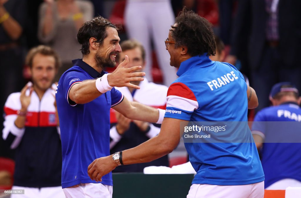 Jeremy Chardy of France celebrates with Yannick Noah the France captain following his victory during the singles match against Daniel Evans of Great Britain on day one of the Davis Cup World Group Quarter-Final between France and Great Britain at Kindarena on April 7, 2017 in Rouen, France.