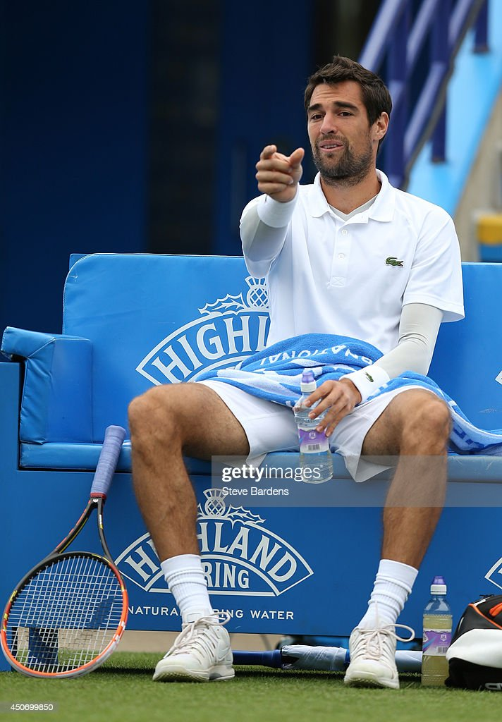 Jeremy Chardy of France disputes a line call against Ivo Karlovic of Croatia during their Men's Singles first round match on day three of the Aegon International at Devonshire Park on June 16, 2014 in Eastbourne, England.
