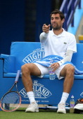 Jeremy Chardy of France disputes a line call against Ivo Karlovic of Croatia during their Men's Singles first round match on day three of the Aegon...