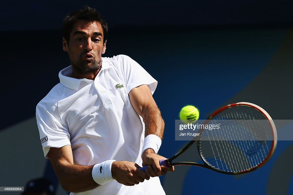 Jeremy Chardy of France plays a backhand against Sam Querrey of the United States of America during day one of the Aegon Championships at Queens Club on June 9, 2014 in London, England.