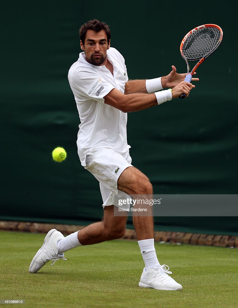 Jeremy Chardy of France plays a backhand during his Gentlemen's Singles first round match against Daniel Cox of Great Britain on day one of the Wimbledon Lawn Tennis Championships at the All England Lawn Tennis and Croquet Club at Wimbledon on June 23, 2014 in London, England.