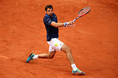 Jeremy Chardy of France plays a backhand during the Men's Singles first round match against Leonardo Mayer of Argentina on day two of the 2016 French...