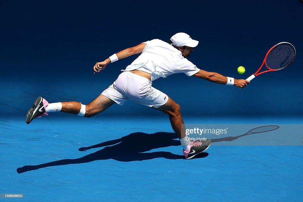 <a gi-track='captionPersonalityLinkClicked' href=/galleries/search?phrase=Jeremy+Chardy&family=editorial&specificpeople=599085 ng-click='$event.stopPropagation()'>Jeremy Chardy</a> of France plays a backhand in his fourth round match against Andreas Seppi of Italy during day eight of the 2013 Australian Open at Melbourne Park on January 21, 2013 in Melbourne, Australia.