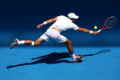 Jeremy Chardy of France plays a backhand in his fourth round match against Andreas Seppi of Italy during day eight of the 2013 Australian Open at...
