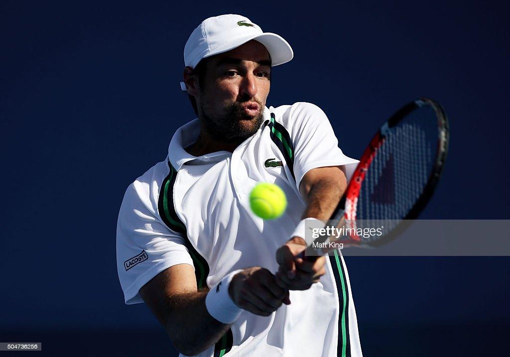 Jeremy Chardy of France plays a backhand in his match against James Duckworth of Australia during day four of the Sydney International at Sydney Olympic Park Tennis Centre on January 13, 2016 in Sydney, Australia.