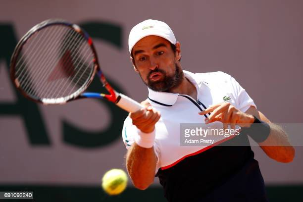 Jeremy Chardy of France plays a forehand during the men's singles second round match against Kei Nishikori of Japan on day five of the 2017 French...