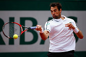Jeremy Chardy of France plays a forehand in his Men's Singles match against Andy Murray of Great Britain on day nine of the 2015 French Open at...