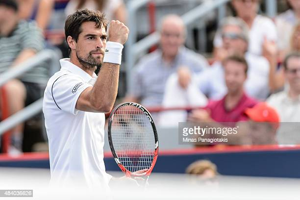 Jeremy Chardy of France reacts after winning the tie break in the second set against John Isner of the USA during day five of the Rogers Cup at...