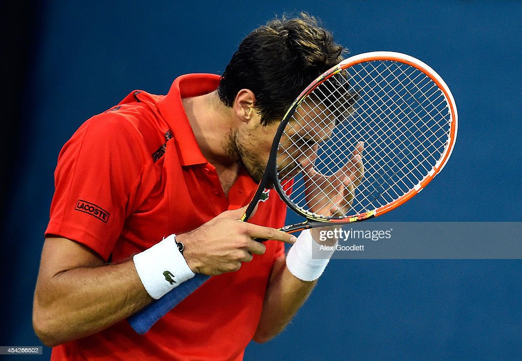Jeremy Chardy of France reacts against <a gi-track='captionPersonalityLinkClicked' href=/galleries/search?phrase=Blaz+Kavcic&family=editorial&specificpeople=7023045 ng-click='$event.stopPropagation()'>Blaz Kavcic</a> of Slovenia during their men's first round match on Day Three of the 2014 US Open at the USTA Billie Jean King National Tennis Center on August 27, 2014 in the Flushing neighborhood of the Queens borough of New York City.