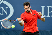 Jeremy Chardy of France returns a shot against Blaz Kavcic of Slovenia during their men's first round match on Day Three of the 2014 US Open at the...