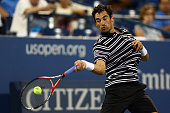 Jeremy Chardy of France returns a shot against David Ferrer of Spain during their Men's Singles Third Round match on Day Five of the 2015 US Open at...