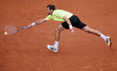 Jeremy Chardy of France returns a shot during his men's singles match against Novak Djokovic of Serbia on day four of the French Open at Roland...
