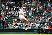 Jeremy Chardy of France returns a shot his during the first round match against Novak Djokovic of Serbia on Day Two of the Wimbledon Lawn Tennis...