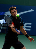 Jeremy Chardy of France returns a shot to Ivo Karlovic of Croatia during the 2015 Shanghai Rolex Masters day 2 at Qi Zhong Tennis Centre on October...