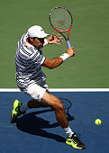 Jeremy Chardy of France returns a shot to Marin Cilic of Croatia during their Men's Singles Fourth Round match on Day Seven of the 2015 US Open at...