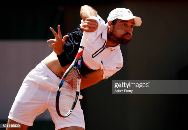 Jeremy Chardy of France serves during the men's singles second round match against Kei Nishikori of Japan on day five of the 2017 French Open at...
