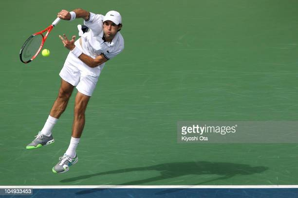 Jeremy Chardy of France serves in his match against Andy Roddick of the United States on day four of the Rakuten Open tennis tournament at Ariake...