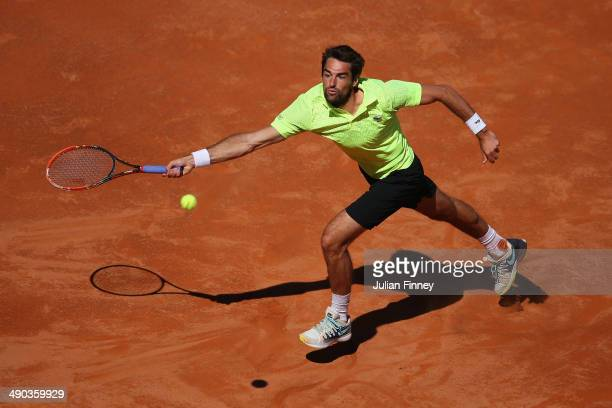 Jeremy Chardy of France stretches for a forehand in his match against Roger Federer of Switzerland during day four of the Internazionali BNL d'Italia...