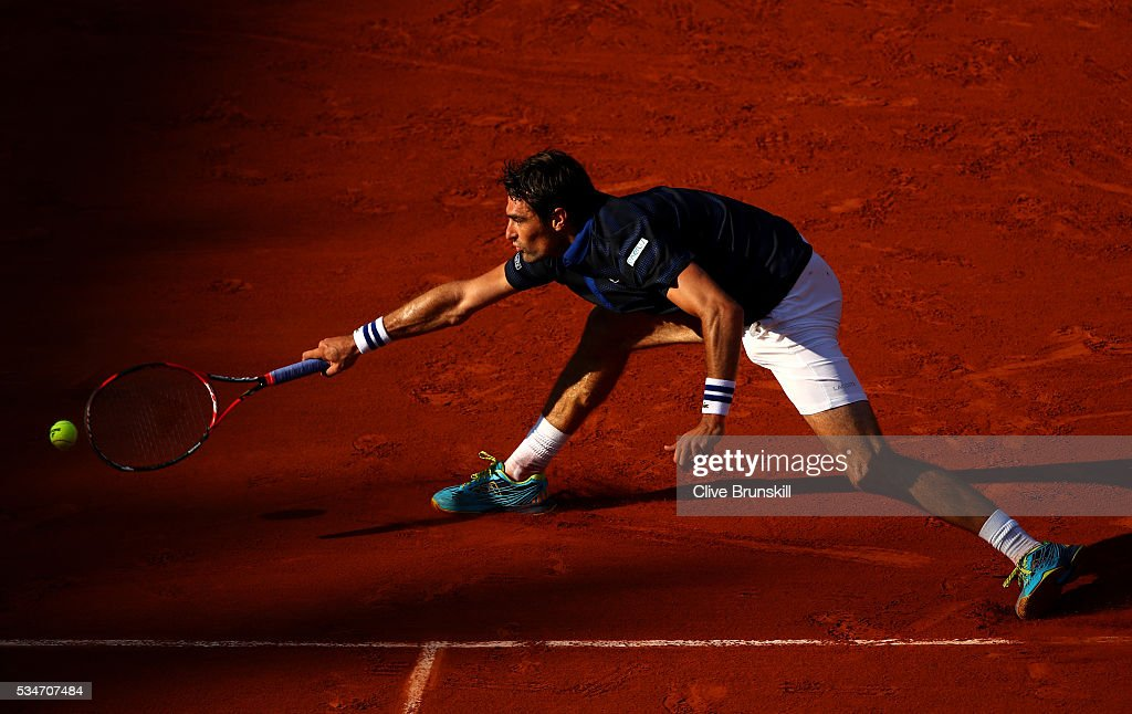 <a gi-track='captionPersonalityLinkClicked' href=/galleries/search?phrase=Jeremy+Chardy&family=editorial&specificpeople=599085 ng-click='$event.stopPropagation()'>Jeremy Chardy</a> of France stretches to hit a forehand during the Men's Singles third round match against Stan Wawrinka of Switzerland on day six of the 2016 French Open at Roland Garros on May 27, 2016 in Paris, France.