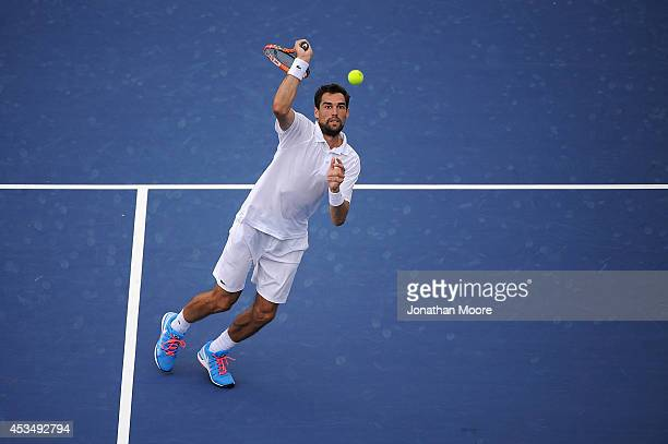 Jeremy Chardy of France vollies to Philipp Kohlschreiber of Germany during a match on day three of the Western Southern Open on August 11 2014 in...
