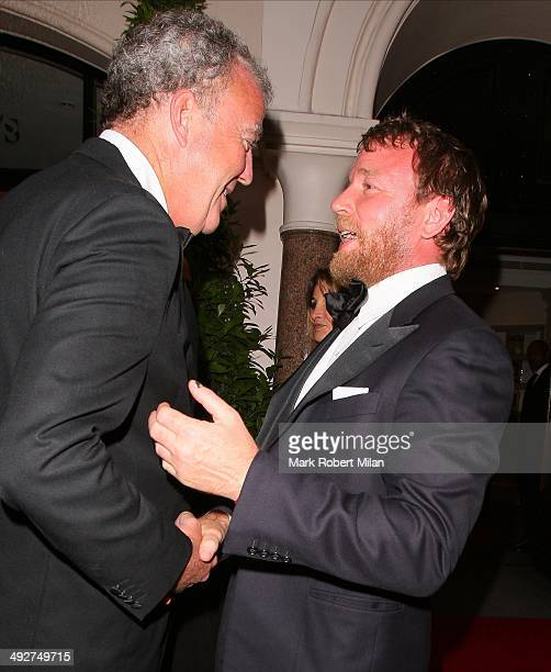 Jeremy Clarkson and Guy Ritchie attending the annual Irish evening at Sotheby's to raise money for eye charity Orbis on May 21 2014 in London England