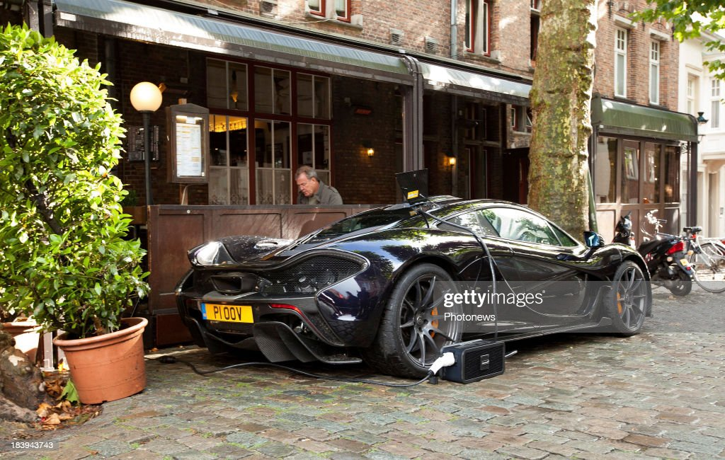 Jeremy Clarkson and the Top Gear crew are pictured during filming in downtown Bruges with a McLaren P1 hybrid car on October 10, 2013 in Bruges, Belgium.