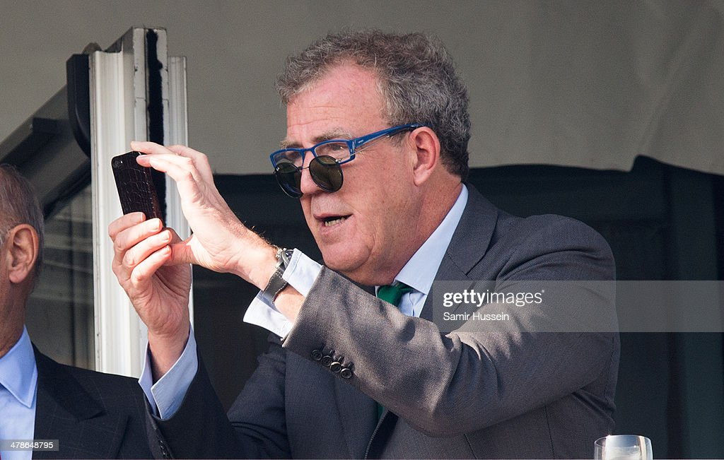 <a gi-track='captionPersonalityLinkClicked' href=/galleries/search?phrase=Jeremy+Clarkson&family=editorial&specificpeople=217586 ng-click='$event.stopPropagation()'>Jeremy Clarkson</a> takes a picture while watching the races during Gold Cup day of The Cheltenham Festival at Cheltenham Racecourse on March 14, 2014 in Cheltenham, England.