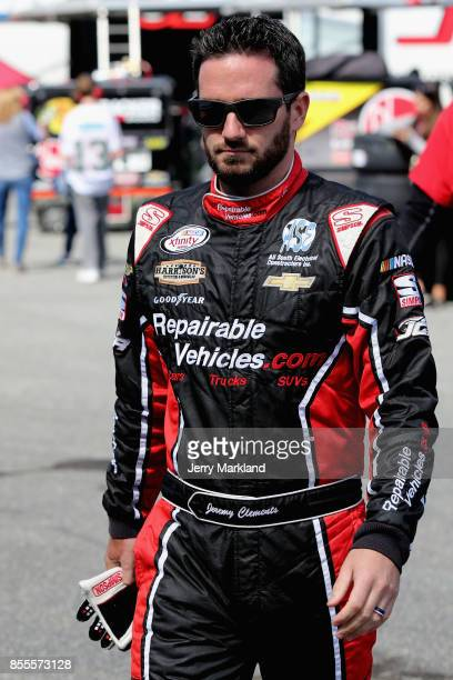 Jeremy Clements driver of the RepairableVehiclescom Chevrolet walks through the garage area during practice for the NASCAR XFINITY Series 'Use Your...