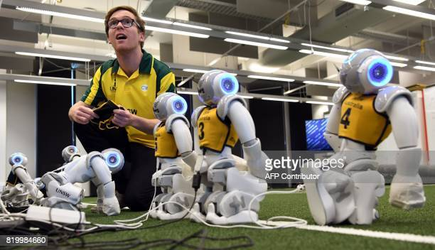 Jeremy Collette prepares soccer robots in Sydney on July 21 as Australias fivetime world champions of robot soccer the University of New South Wales'...