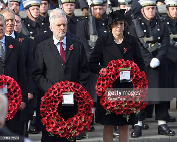 Jeremy Corbyn and Theresa May attend the annual Remembrance Sunday Service at the Cenotaph on Whitehall on November 13 2016 in London England The...