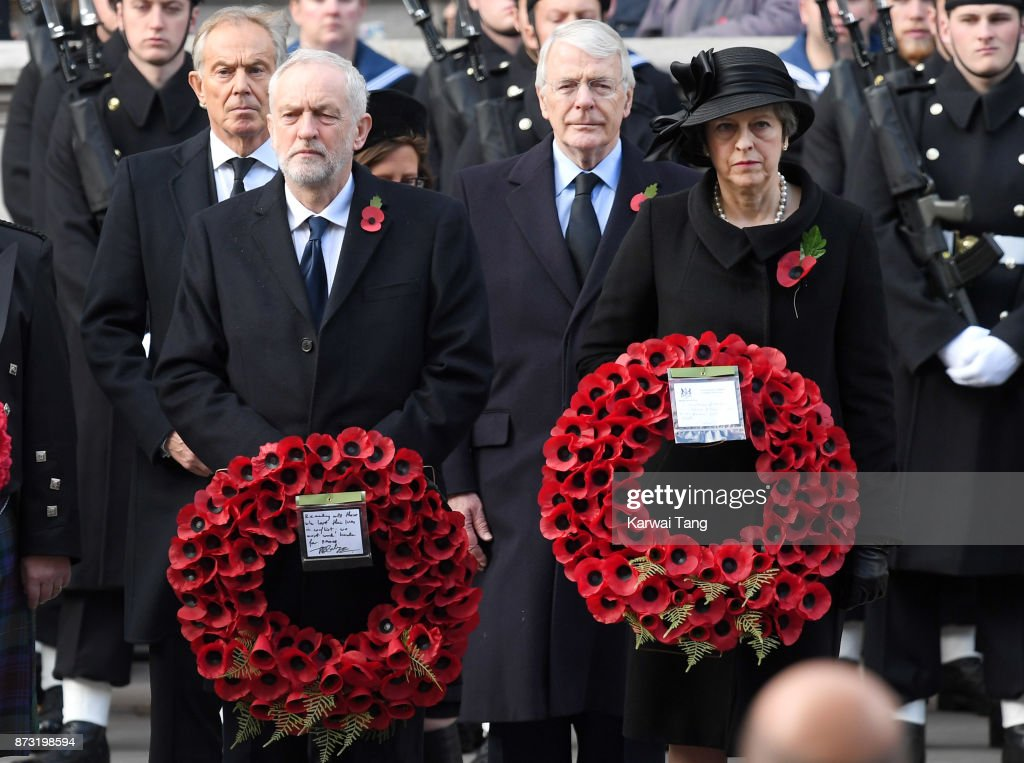 Jeremy Corbyn and Theresa May during the annual Remembrance Sunday Service at The Cenotaph on November 12, 2017 in London, England.