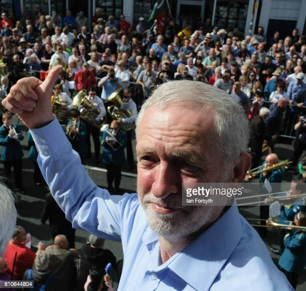 Jeremy Corbyn leader of the Labour Party stands in the balcony of the County Hotel as colliery bands pass below during the 133rd Durham Miners Gala...