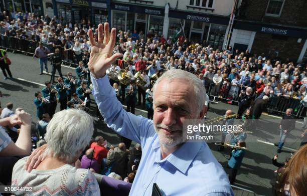 Jeremy Corbyn leader of the Labour Party stands on the balcony of the County Hotel as colliery bands pass below during the 133rd Durham Miners Gala...