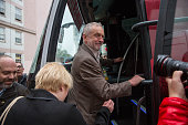 Jeremy Corbyn leader of the UK opposition Labour Party center looks towards photographers as he gets on the 'Labour In Britain' campaign bus during...