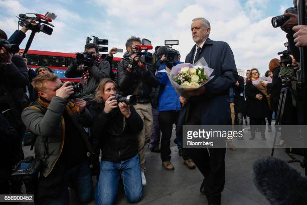 Jeremy Corbyn leader of the UK opposition Labour party lays flowers as he pays his respects to the victims of the terror attack outside the Palace of...