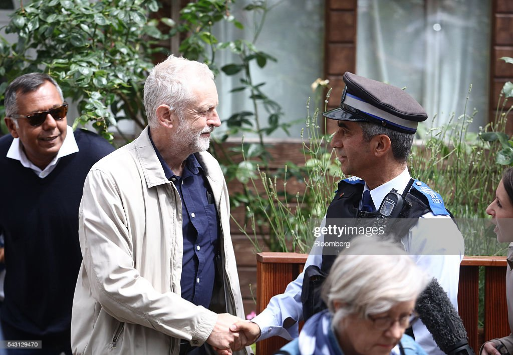 <a gi-track='captionPersonalityLinkClicked' href=/galleries/search?phrase=Jeremy+Corbyn&family=editorial&specificpeople=2596361 ng-click='$event.stopPropagation()'>Jeremy Corbyn</a>, leader of the U.K. opposition Labour Party, shakes hands with a police officer as he leaves his house in London, U.K, on Sunday, June 26, 2016. Senior Labour lawmaker Hilary Benn called on <a gi-track='captionPersonalityLinkClicked' href=/galleries/search?phrase=Jeremy+Corbyn&family=editorial&specificpeople=2596361 ng-click='$event.stopPropagation()'>Jeremy Corbyn</a> to resign as party leader and suggested other members of Corbyns senior team will follow suit. Photographer: Chris Ratcliffe/Bloomberg via Getty Images