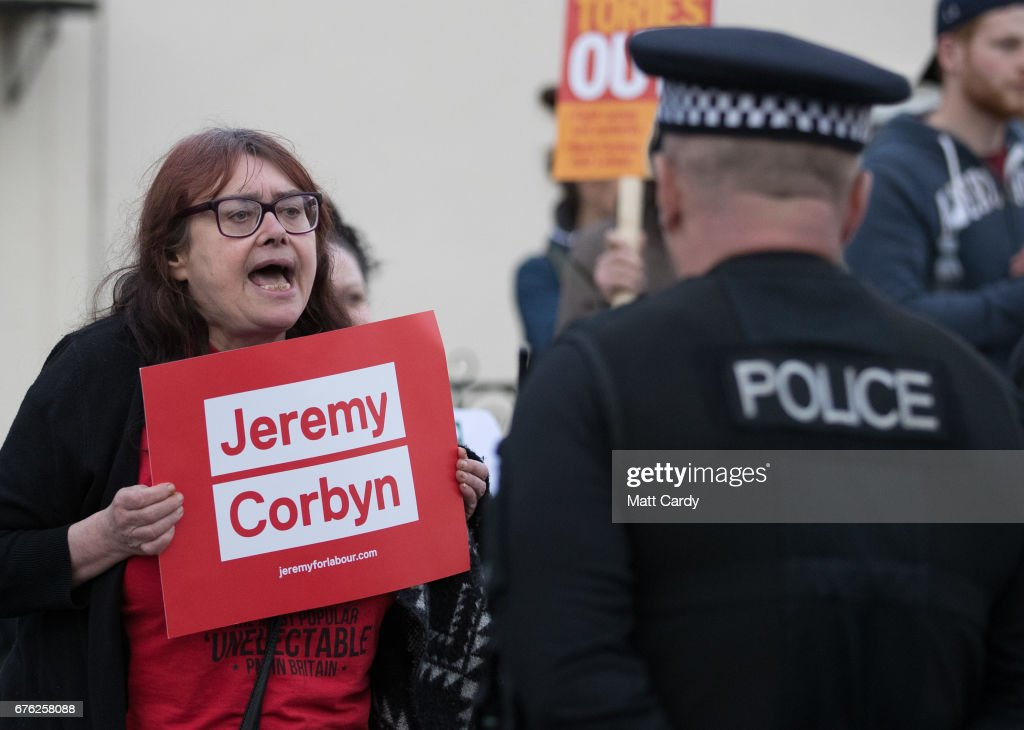 A Jeremy Corbyn supporter holds up a sign as Britain's Prime Minister Theresa May makes a campaign stop on May 2, 2017 in Bristol, England. The Prime Minister is campaigning in South-West England, a former Liberal Democrat stronghold, as she urges West Country voters to stick with her party ahead of the polls on June 8.