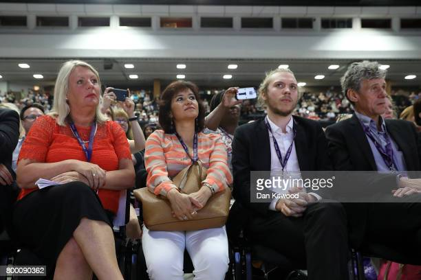 Jeremy Corbyn's wife Laura Alvarez listens as he speaks to delegates at the Unison Conference on June 23 2017 in Brighton England The Labour Party...